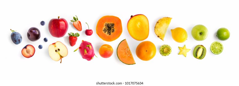 Creative layout made of fruits. Flat lay. Plum, apple, strawberry, blueberry, papaya, pineapple, lemon, orange, lime, kiwi, melon, apricot, pitaya, mango and carambola on the white background. - Shutterstock ID 1017075634