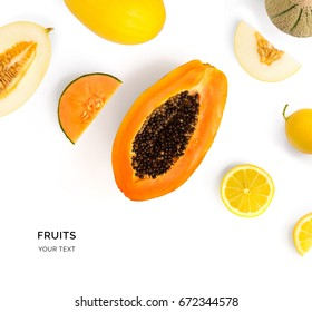 Creative layout made of fruits. Flat lay. Food concept. Papaya, lemon, melon on white background.