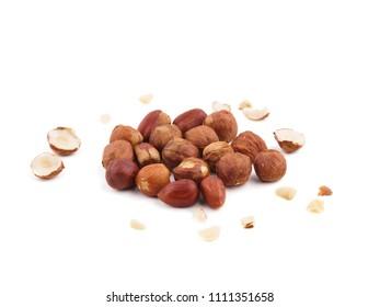 Creative layout made of hazelnut nuts on white background.