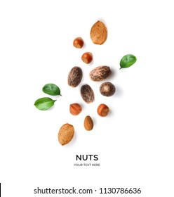 Creative layout made of hazelnut nuts, almonds and nutmeg on white background.Flat lay. Food concept.