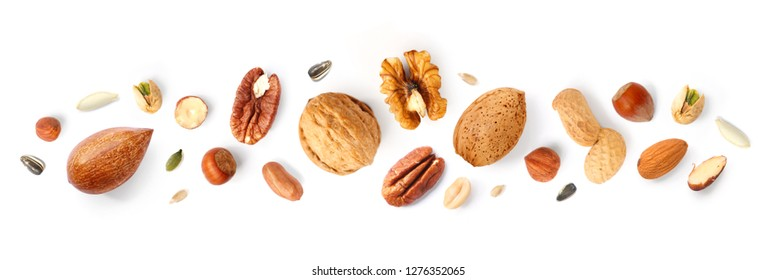 Creative layout made of hazelnut nuts, almonds, walnut, peanut, pecan, sunflower seeds on white background.Flat lay. Food concept.