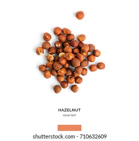 Creative layout made of hazelnut nuts on white background.Flat lay. Food concept.