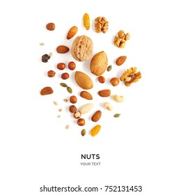 Creative layout made of hazelnut nuts, almonds, walnut, peanut, cashew on white background.Flat lay. Food concept.