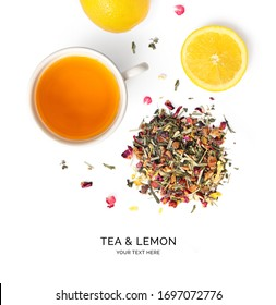 Creative layout made of herbal tea and lemon on the white background. Flat lay. Macro  concept.