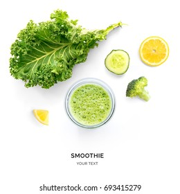 Creative layout made of kale, cucumber and broccoli smoothie. Flat lay. Food concept. Smoothie on the white background.