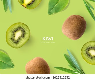 Creative layout made of kiwi and leaves. Flat lay. Food concept. Kiwi on green background.