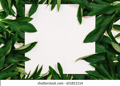 Creative layout made of leaves with white paper card note. Flat lay. Copy space for text.