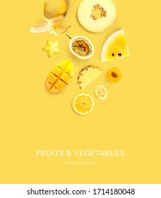 Creative layout made of  lemon, melon, passionfruit, banana, passion fruit, mango, plum, pineapple on the yellow background. Flat lay. Food concept. Macro  concept.