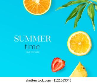 Creative layout made of lemon, strawberry and orange on blue background. Flat lay. Food concept. Summer fruit.