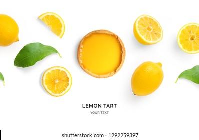 Creative layout made of lemon tart and lemons on white background. Flat lay. Food concept.