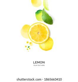 Kreatives Layout aus Zitrone mit Aquarellpunkten auf weißem Hintergrund. Flat lay. Lebensmittelkonzept.