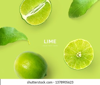 Creative layout made of lime. Flat lay. Food concept. Macro concept. Green background.