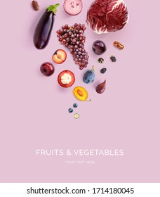 Creative layout made of mangosteen, onion, grapes, plum, blueberry, blackberry, dates, eggplant  on the purple background. Flat lay. Food concept. Macro  concept.