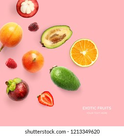 Creative layout made of orange, strawberry, sweet granadilla, blackberry and feijoa. Flat lay. Food concept. Tropical fruits on the yellow background.