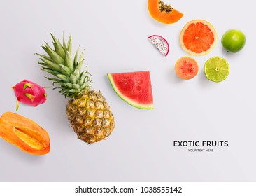 Creative layout made of papaya, pineapple, grapefruit, guava, watermelon, dragon fruit and lime. Flat lay. Food concept.