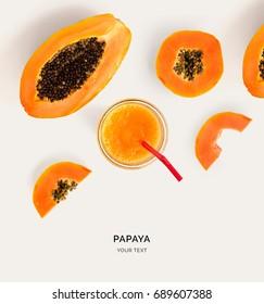 Creative layout made of papaya smoothie. Flat lay. Food concept. Papaya on the light background.