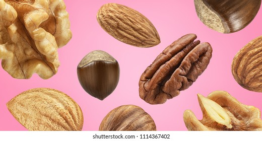 Creative layout made pattern nut mix Flat lay isolated pink background. Macro concept. Mockup hazelnut, almond,  pecan, walnut  as package design element.