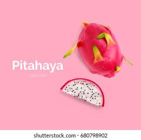 Creative layout made of pitahaya (dragonfruit). Flat lay. Food concept.  Pitahaya (dragonfruit)  on pink background.