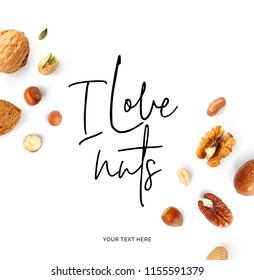 "Creative layout made of  quote ""I love nuts"". Food concept. Hazelnut nuts, almonds, walnut, peanut, pecan, cashew on white background."