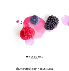 Creative layout made of raspberry, blueberry and blackberry on the watercolor background.. Flat lay. Food concept.