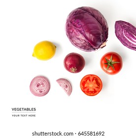 Creative layout made of red cabbage, onion, tomatoes and lemon. Flat lay. Food concept. Vegetables isolated on white background.