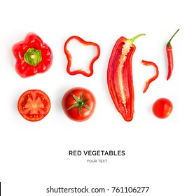 Creative layout made of red pepper, tomato and chilli pepper. Flat lay. Food concept. Red vegetables isolated on white background.