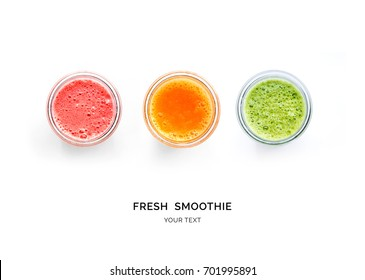 Creative layout made of smoothies. Flat lay. Food concept. Smoothies on the white background.