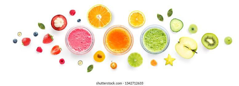 Creative layout made of smoothies and fruits around. Flat lay. Food concept. Smoothies on the white background.