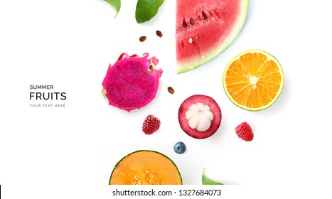 Creative layout made of summer fruits.  Tropical flat lay. Food concept. Melon, watermelon, mangosteen, dragonfruit and  loganberry on white background.