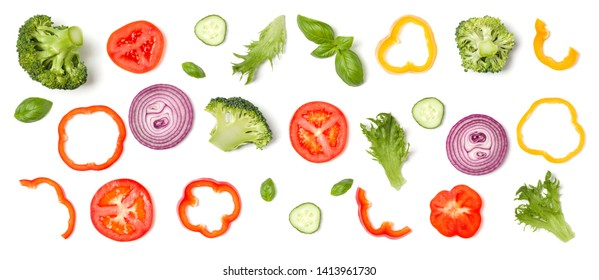 Creative layout made of tomato slice, onion, cucumber, basil leaves. Flat lay. Food concept. Vegetables isolated on white background.