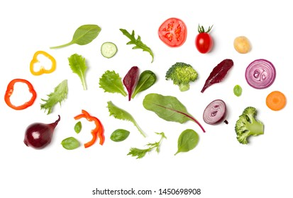 Creative layout made of tomato slice, onion, cucumber, basil leaves. Flat lay, top view. Vegetables isolated on white background. Food ingredient pattern.