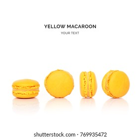 Creative layout made of yellow macaroons on the white background. Flat lay. Food concept.