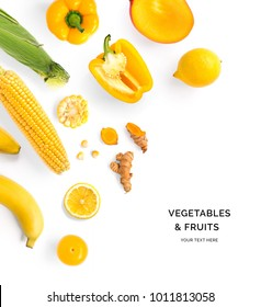 Creative layout made of yellow vegetables and fruits. Flat lay. Food concept. Lemon, yellow pepper, corn, mango, banana and turmeric on the white background.