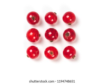 Creative layout of red currant berries. Food and diet concept. Top view of ripe red currant berries with copy space. Isolated on white with clipping path.