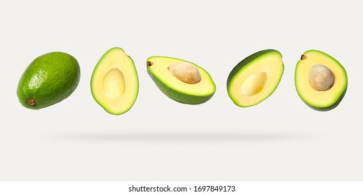 Creative layout with ripe flying avocado halves on light background. Healthy food, diet, tropical exotic fruit, trendy food product. Minimalistic summer food concept. Organic avocado. Pop art design - Shutterstock ID 1697849173