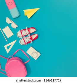 Creative layout of school supplies against pastel blue background. Minimal back to school concept. Flat lay.