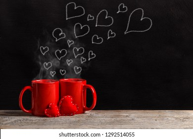 Creative Love or Valentine's Day Concept with Hearts drawing on a chalkboard