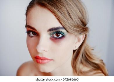 creative make up applying by artist in studio