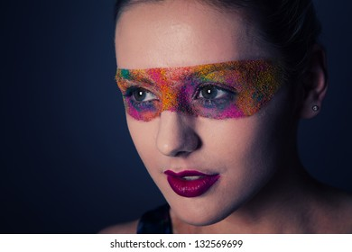 Creative make up on young beautiful model, close up