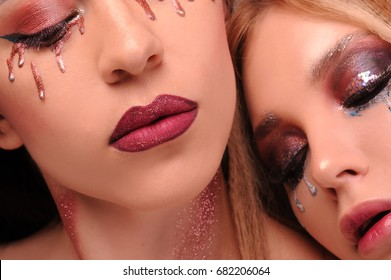 Creative make-up. Bright photos. Colored tears. Tears in the makeup.