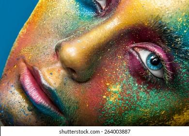 Creative make-up of colored powder closeup