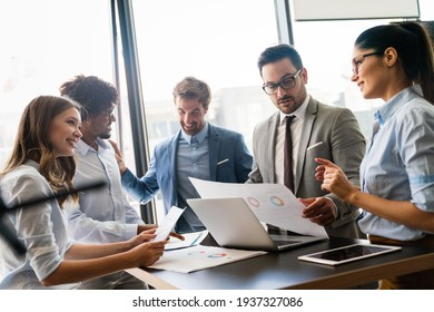 Creative managers crew working with new startup project in office. Team brainstorming. - Shutterstock ID 1937327086