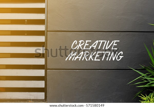CREATIVE MARKETING - business concept words on the wall