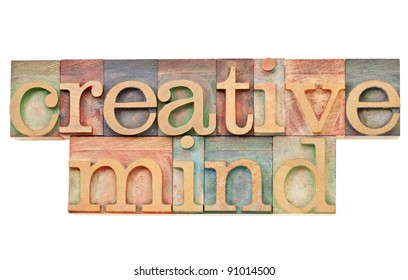creative mind - isolated text in vintage wood letterpress printing blocks stained by color inks