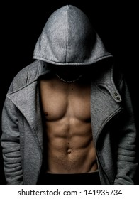 Creative muscle athletic man, abdominal on black isolated background