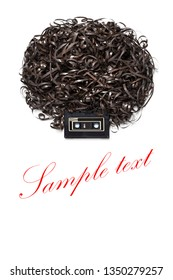 Creative music concept photo of retro vintage audio cassette with the tape forming human head with afro hairdress on white background.