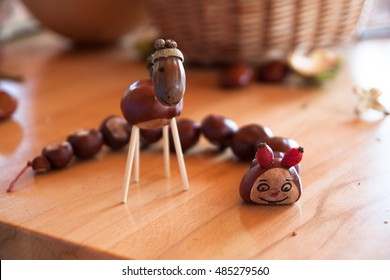 creative natural children toys handmade from chestnuts and acorns with basket in the background