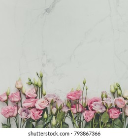 Creative natural composition made of flowers and leaves on marble background. Flat lay. Love concept.