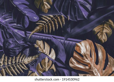 Creative nature background. Gold and Purple  tropical Monstera and palm leaves. Minimal summer abstract jungle or forest pattern.