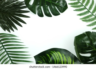 Creative nature layout made of tropical leaves on white background. Flat lay. Summe